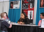 Tia Carrere at her table