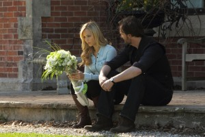Elena (Laura Vandervoort) receives some flowers but from whom? Jeremy (Greg Bryk) is probably wondering the same thing