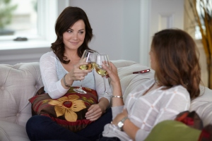 Erica Durance as Alex Reid and Wendy Crewson as Dana Kinney clink their glasses for an unknown toast