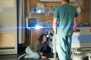 Liane Balaban with Michael Shanks (back to camera) as Charlie Harris
