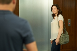 Alex (Erica Durance) and Charlie (Michael Shanks -back to camera)