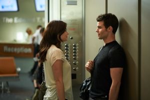 Alex (Erica Durance) and Joel (Daniel Gillies) in the elevator hopefully not to make out
