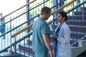 Erica Durance as Alex Reid and Michael Shanks as Charlie Harris