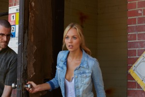 Thomas Leblanc (Curtis Caravaggio) lurks as Elena (Laura Vandervoort) comes outside