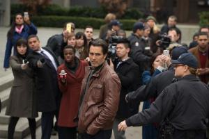 Victor Webster as Carlos Fonnegra surrounded by reporters