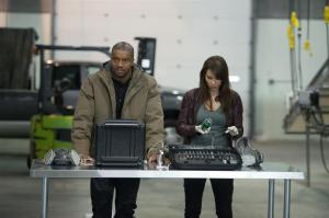 Roger Cross as Travis and Lexa Doig as Sonja