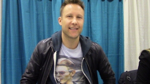 Michael Rosenbaum at his table