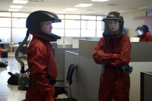 Kiera (Rachel Nichols) and Dillon (Brian Markinson) wearing matching hazmat suits