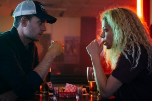 Jesse (Patrick J. Adams) and Helena (Tatiana Maslany) share a drink