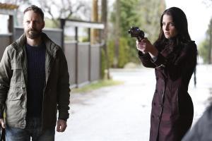 John Doe (Ryan Robbins) and Kiera (Rachel Nichols) getting ready for a showdown
