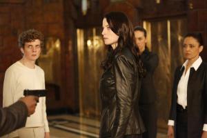Sadler (Erik Knudsen), Kiera (Rachel Nichols), a unknown Freelancer and Catherine (Rachael Crawford) being held at gunpoint by an unknown assailant.