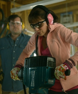Donnie (Kristian Bruun) watches as Alison (Tatiana Maslany) takes a jack hammer to the floor (perhaps to bury Dr. Leekie?)