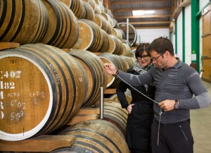 Pierre-in-barrel-room-at-Calvados-Boulard-taking-a-sample