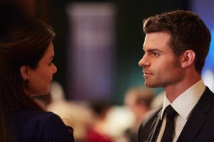 Erica Durance as Alex Reid and Daniel Gillies as Joel Goren
