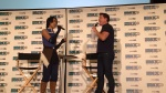 A fan and John Barrowman duet at his panel