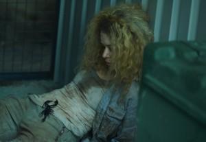Tatiana Maslany as Helena and her scorpion friend