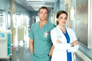 Michael Shanks as Dr. Charlie Harris and Erica Durance as Dr. Alex Reid