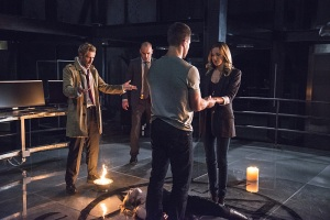 "Arrow -- ""Haunted"" -- Image AR404B_0027b.jpg -- Pictured (L-R) Matt Ryan as Constantine, Paul Blackthorne as Detective Quentin Lance, Stephen Amell as Oliver Queen and Katie Cassidy as Laurel Lance -- Photo: Cate Cameron/ The CW -- © 2015 The CW Network, LLC. All Rights Reserved."