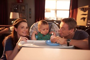 Erica Durance as Alex Reid, baby Luke, and Michael Shanks as Charlie Harris