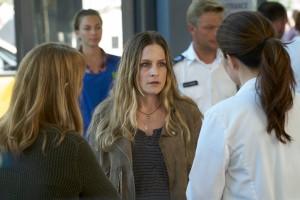Tara Spencer-Nairn as Janice Fenn  and Erica Durance as Alex Reid