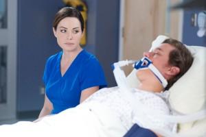 Erica Durance as Dr. Alex Reid