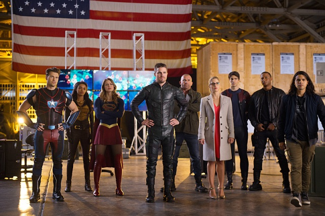 "DC's Legends of Tomorrow --""Invasion!""-- Image LGN207c_0418.jpg -- Pictured (L-R): Nick Zano as Nate Heywood/Steel, Maisie Richardson- Sellers as Amaya Jiwe/Vixen, Melissa Benoist as Kara/Supergirl, Stephen Amell as Oliver Queen, Dominic Purcell as Mick Rory/Heat Wave, Emily Bett Rickards as Felicity Smoak, Brandon Routh as Ray Palmer/Atom, David Ramsey as John Diggle and  Carlos Valdes as Cisco Ramon -- Photo: Diyah Pera/The CW -- © 2016 The CW Network, LLC. All Rights Reserved."