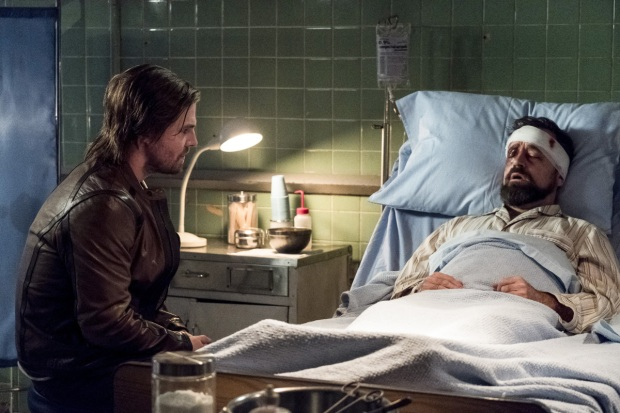 """Arrow -- """"Bratva"""" -- Image AR512b_0005b.jpg -- Pictured (L-R): Stephen Amell as Oliver Queen and David Nyki as Anatoly Knyazev -- Photo: Cate Cameron/The CW -- © 2017 The CW Network, LLC. All Rights Reserved."""