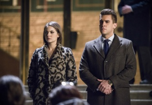 "Arrow -- ""Fighting Fire With Fire"" -- Image AR515b_0274b.jpg -- Pictured (L-R): Willa Holland as Thea Queen and Josh Segarra as Adrian Chase, -- Photo: Diyah Pera/The CW -- © 2017 The CW Network, LLC. All Rights Reserved."