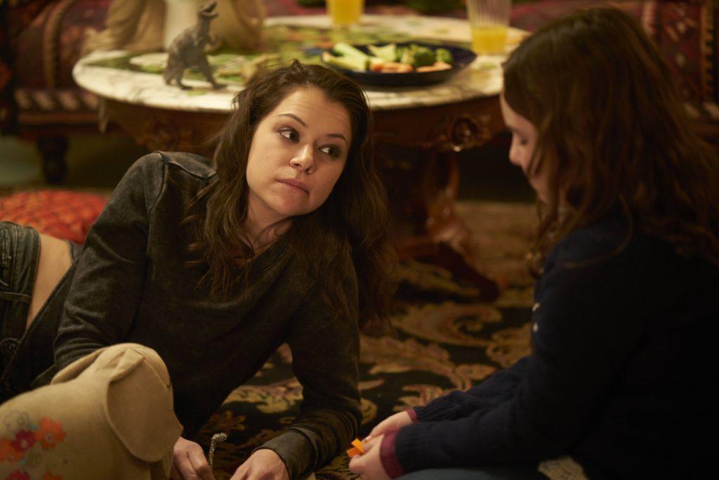 Sarah (Tatiana Maslany) and Kira (SkylerWexler)